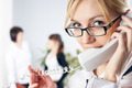 Young beautiful businesswoman calling by phone in office - PhotoDune Item for Sale