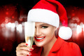 Happy Christmas Girl in Santa Hat with champagne glass. Cheers - PhotoDune Item for Sale