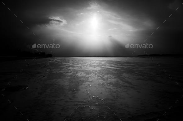 Dramatic frozen river landscape, black and white