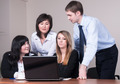 Business people arranged brainstorming behind the laptop at office - PhotoDune Item for Sale