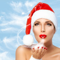 Magical Christmas Woman in Santa Hat Blowing Sparkling Stardust - PhotoDune Item for Sale