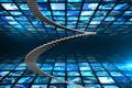 Winding stairs against walls of digital screens in blue