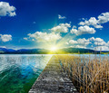 Pier in the lake, countryside on sunset