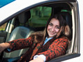 Young pretty smiling girl sitting behind the wheel of a car - PhotoDune Item for Sale