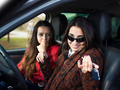 Two cute young smiling girl sitting in a car - PhotoDune Item for Sale