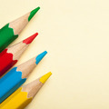 Four Colored Pencils On Empty Paper Blank. - PhotoDune Item for Sale