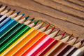 Many Different Colored Pencils On Wooden Table. - PhotoDune Item for Sale