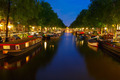 Night city view of Amsterdam canal with Houseboat - PhotoDune Item for Sale