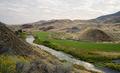 River Flows Through Farmland John Day National Monument Oregon - PhotoDune Item for Sale