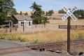 Railroad Crossing Sign Tracks Abandoned House Rural Ranch Farmland - PhotoDune Item for Sale