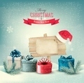 Christmas winter background with presents and wooden board.  - PhotoDune Item for Sale