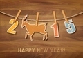 2015 with a goat on wooden background.  - PhotoDune Item for Sale