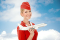 Charming Stewardess Holding Airplane In Hand.  - PhotoDune Item for Sale