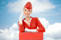 Charming Stewardess Dressed In Red Uniform And Suitcase.  - PhotoDune Item for Sale