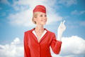 Charming Stewardess Dressed In Red Uniform Pointing The Finger. - PhotoDune Item for Sale