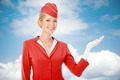 Charming Stewardess Dressed In Red Uniform Holding In Hand.  - PhotoDune Item for Sale