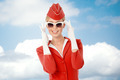 Charming Stewardess Dressed In Red Uniform And Vintage Sunglasses - PhotoDune Item for Sale