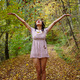 Young woman throwing autumn leaves in the air - PhotoDune Item for Sale