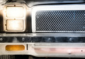 Detail of Illuminated Headlight and Grille of Car - PhotoDune Item for Sale