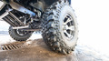 Car tire with offroad pattern close-up on road. - PhotoDune Item for Sale