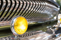 Yellow head light of retro car and radiator grille. - PhotoDune Item for Sale