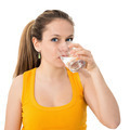 woman drinking water against white background - PhotoDune Item for Sale