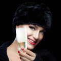 Winter Fashion Young Woman in Fur Hat Toasting with Champagne - PhotoDune Item for Sale