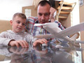 father and son assembling airplane toy - PhotoDune Item for Sale