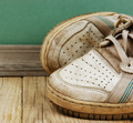 old leather shoes on a wooden floor - PhotoDune Item for Sale