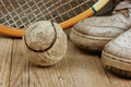 old tennis ball and sneakers on a wooden floor - PhotoDune Item for Sale