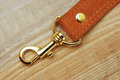 leather strap with carabiner on a wooden board - PhotoDune Item for Sale