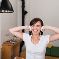 Vivacious young woman listening to music - PhotoDune Item for Sale