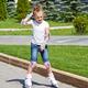 Learning girl on roller skates - PhotoDune Item for Sale