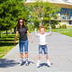 Learning mother and daughter on roller skates - PhotoDune Item for Sale