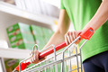 Woman with trolley at supermarket - PhotoDune Item for Sale