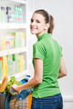 Smiling woman shopping at supermarket - PhotoDune Item for Sale