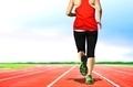 Women Jogging on Running Tracks