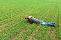 man lying on green field and photographs - PhotoDune Item for Sale