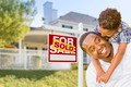 African American Father and Mixed Race Son In Front of Sold Home For Sale Sign and New House - PhotoDune Item for Sale