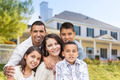 Happy Hispanic Family Portrait in Front of Beautiful House. - PhotoDune Item for Sale