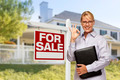 Female Real Estate Agent in Front of Home For Sale Sign and House. - PhotoDune Item for Sale