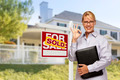 Female Real Estate Agent in Front of Sold Home For Sale Sign and House. - PhotoDune Item for Sale