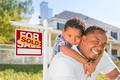 African American Father and Mixed Race Son In Front of Sold Home For Sale Real Estate Sign and House - PhotoDune Item for Sale