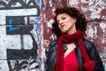 Pretty woman waiting at graffiti wall - PhotoDune Item for Sale