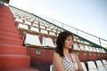 Retro girl sitting in stadium - PhotoDune Item for Sale