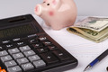 Business Charts with calculator, money, piggy box and pen - PhotoDune Item for Sale