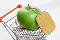 green apple with tag in shopping carts on white background - PhotoDune Item for Sale