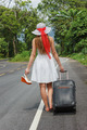 young girl walking down the road with a suitcase - PhotoDune Item for Sale
