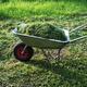 wheelbarrow on a lawn with fresh grass - PhotoDune Item for Sale