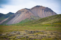 Iceland Caked Lava field and mountains landscape - PhotoDune Item for Sale